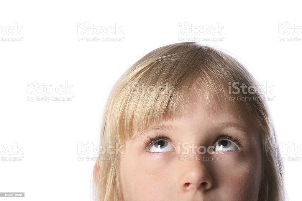 Little girl looking up on white background stock photo