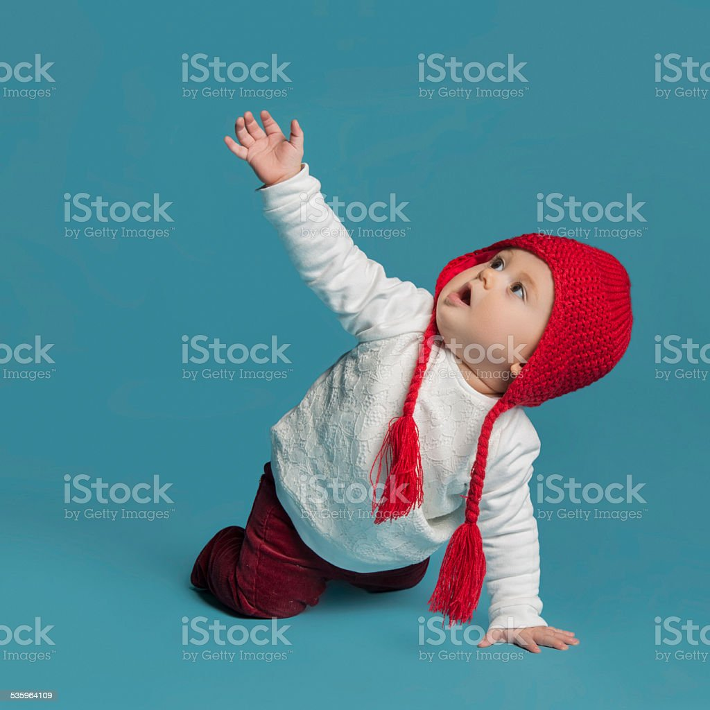Little girl looking up stock photo