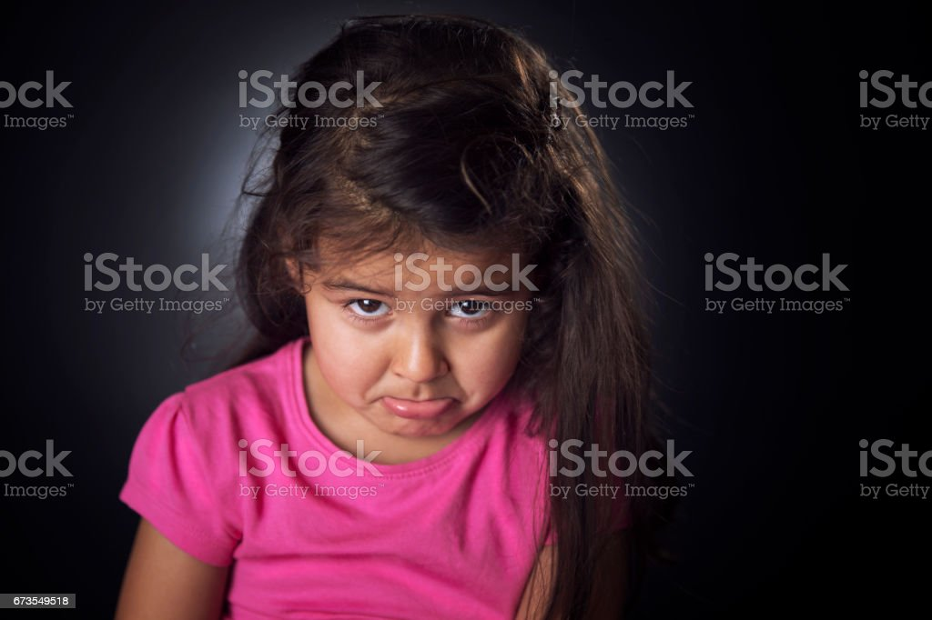 Little girl looking upset royalty-free stock photo