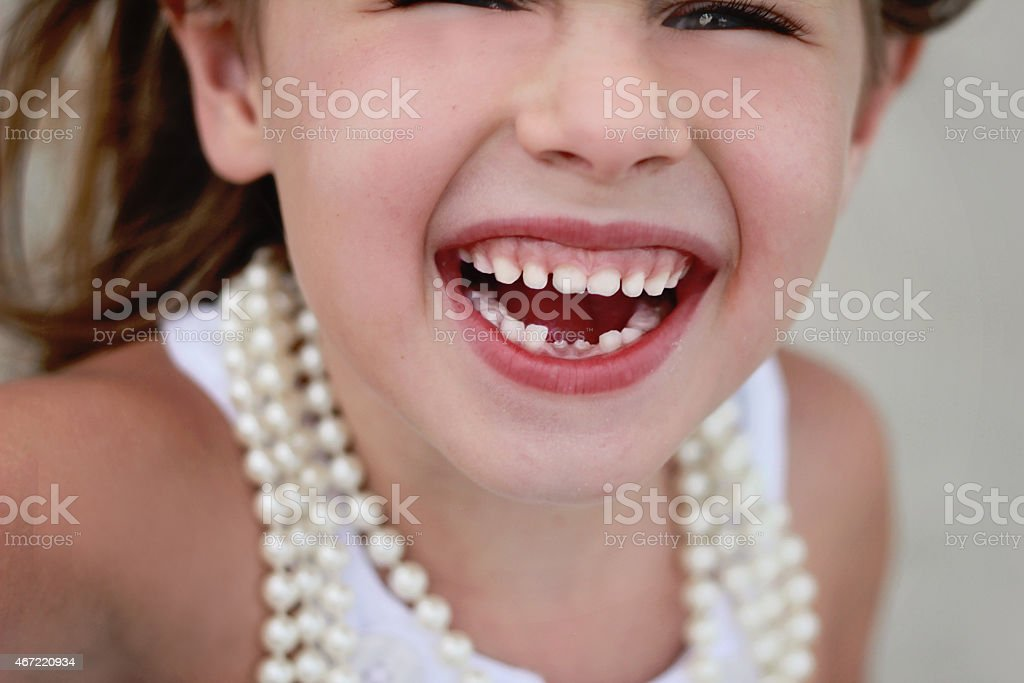 little girl loses her baby teeth stock photo