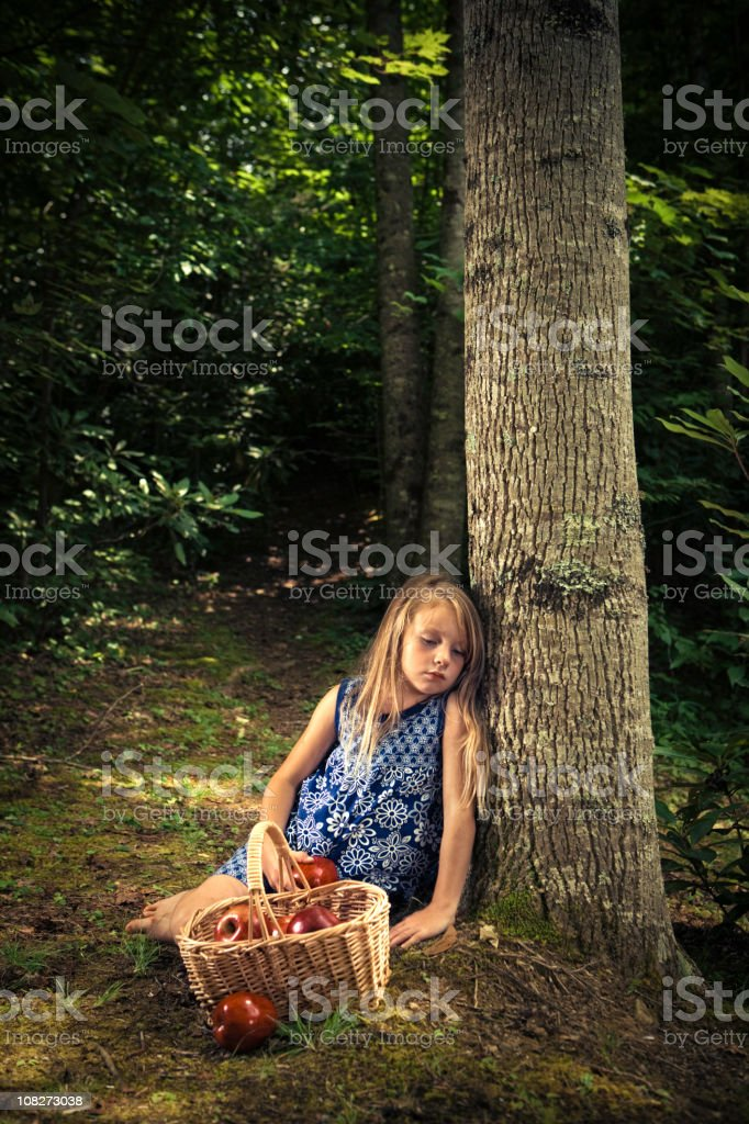 little girl lost in the forest stock photo