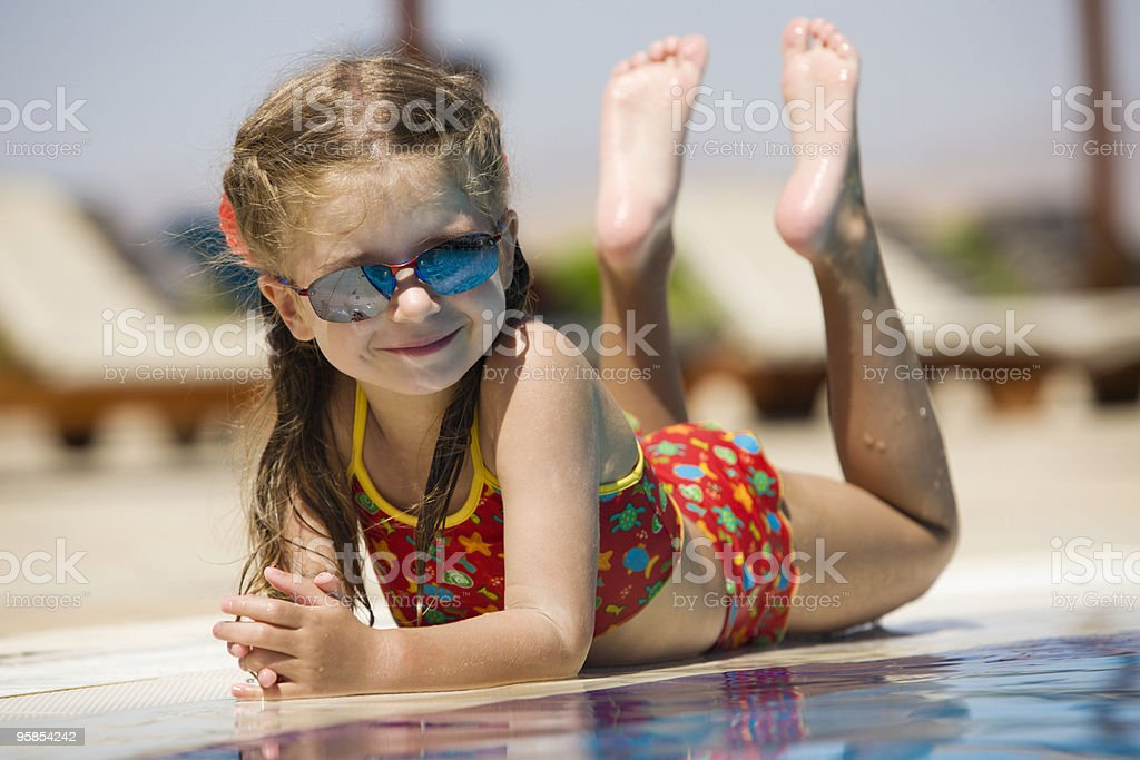 Little girl lying near pool royalty-free stock photo