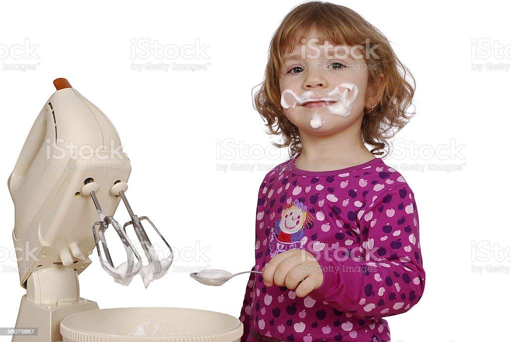little girl made cream for cake royalty-free stock photo