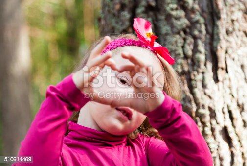 Little girl make heart