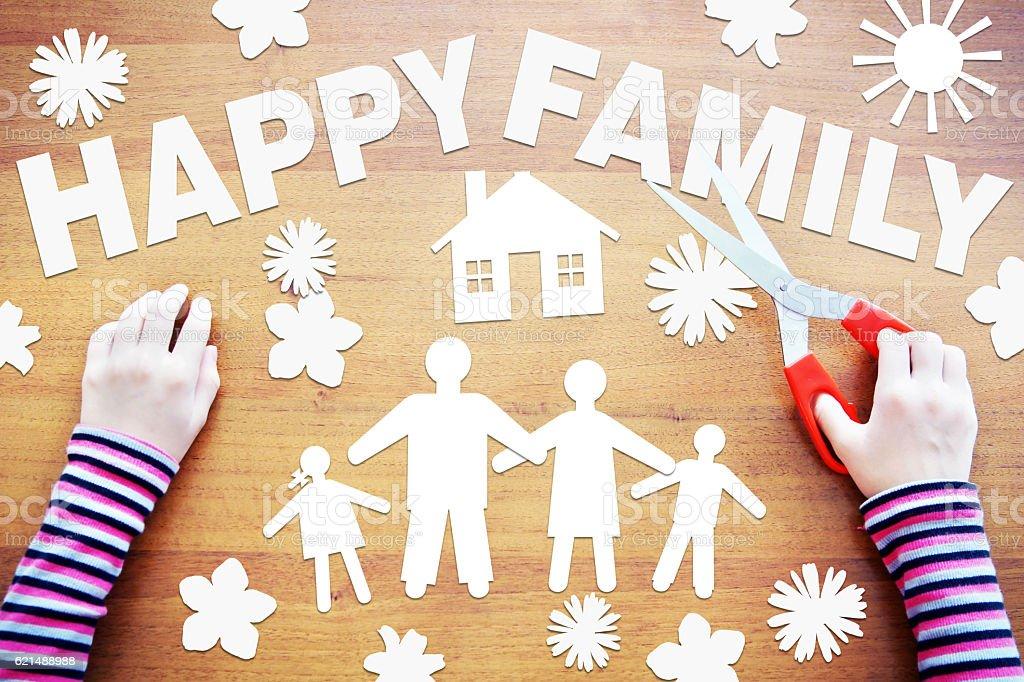 Little girl makes composition about happy family photo libre de droits