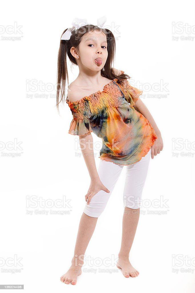 Little girl making a face and sticking her tongue out royalty-free stock photo