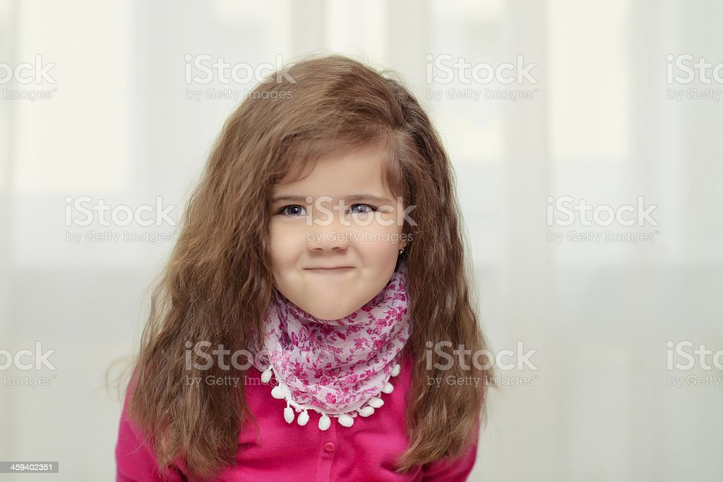 little girl making a face royalty-free stock photo