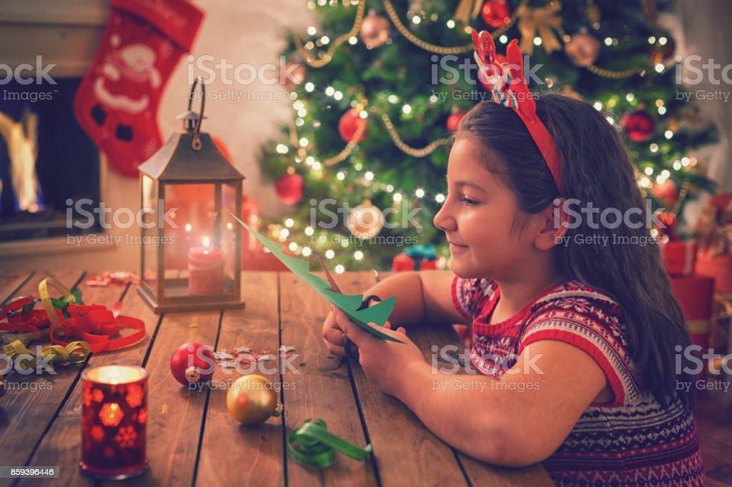 Little Girl Making Christmas Card stock photo