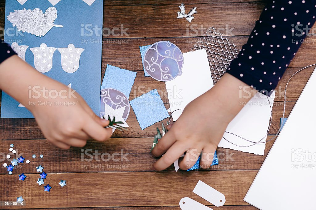 Little girl making Christmas cards stock photo