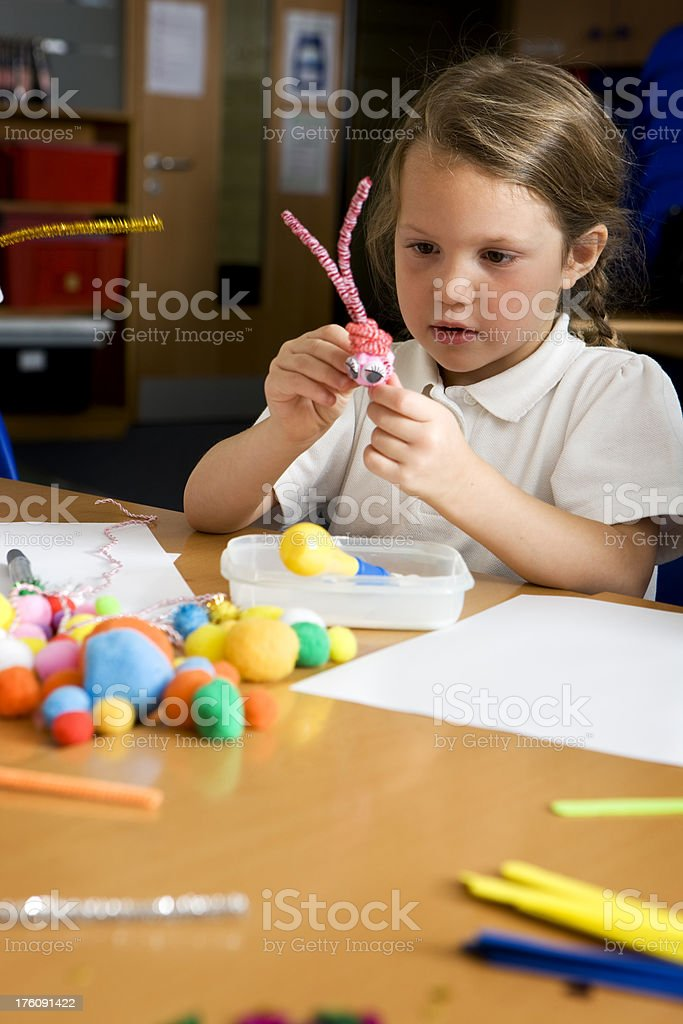 Little girl making crafts in school. royalty-free stock photo