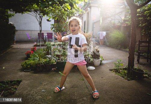 Cute little girl in her backyard
