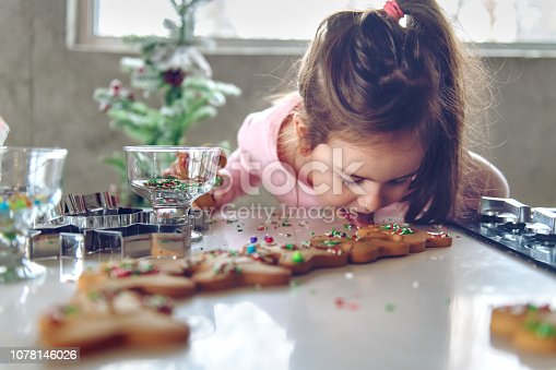 5 years old little girl making gingerbread cookies