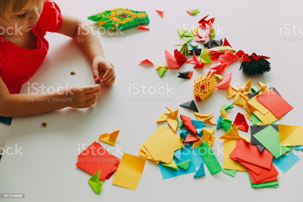 Little Girl Making Origami Crafts With Paper Stock Photo More