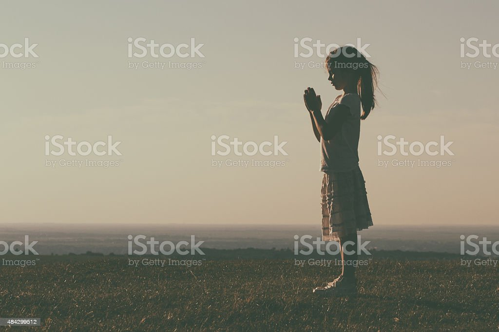 Little girl meditating stock photo