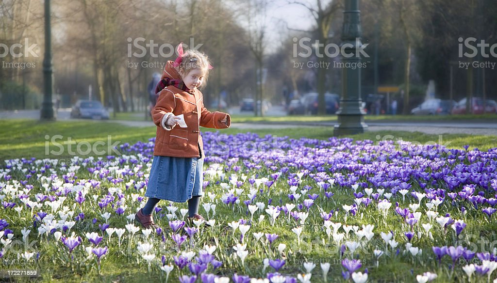 Little girl midst of flowers royalty-free stock photo