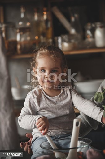 istock Little girl mixing vegetables, preparing salad 1135709062