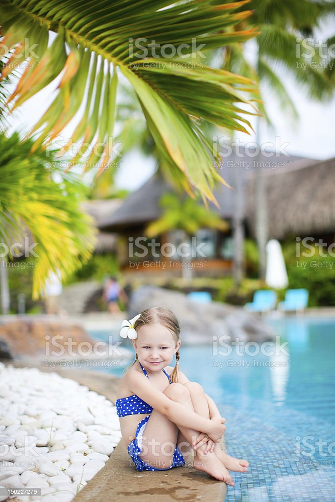 Little girl near swimming pool royalty-free stock photo
