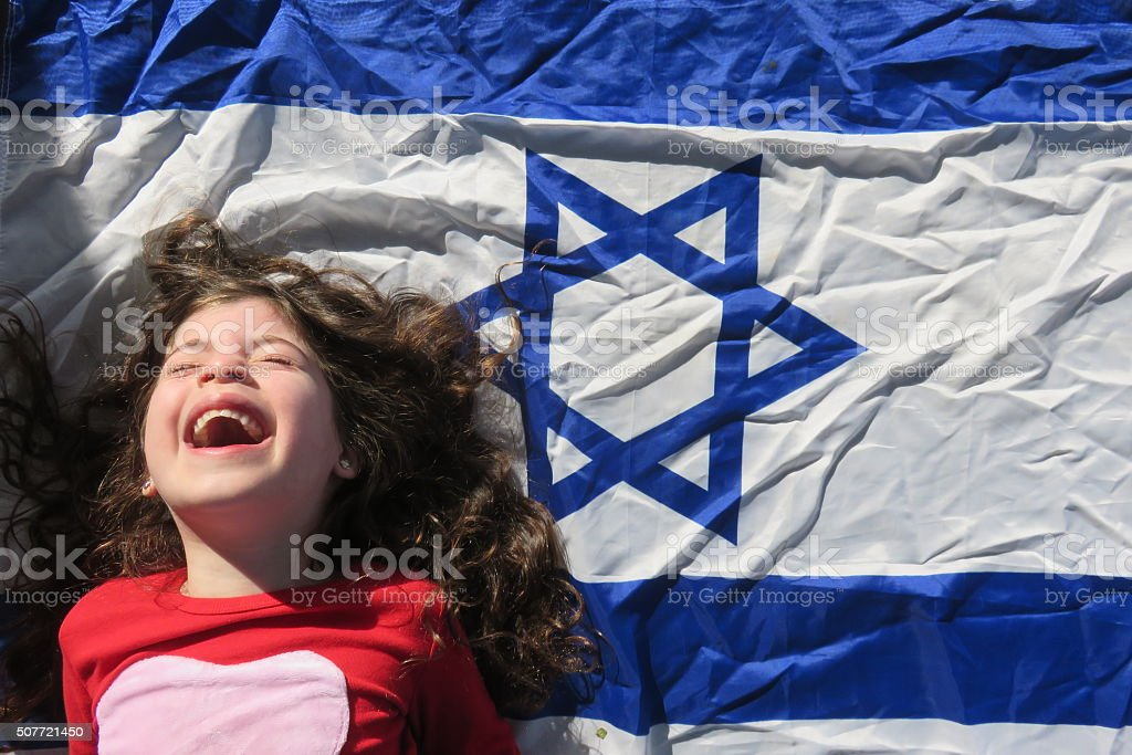 Little girl near the Israeli flag stock photo