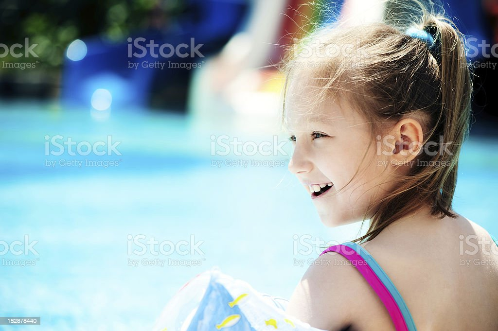 Little girl near the pool royalty-free stock photo