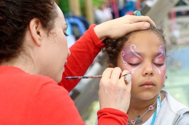 Little girl of is getting her face paint outdoors picture id171315016?b=1&k=6&m=171315016&s=612x612&w=0&h=teyhlj0 rxdiqsay6lbv74sfmxypwiu5dkfk2jkg  i=