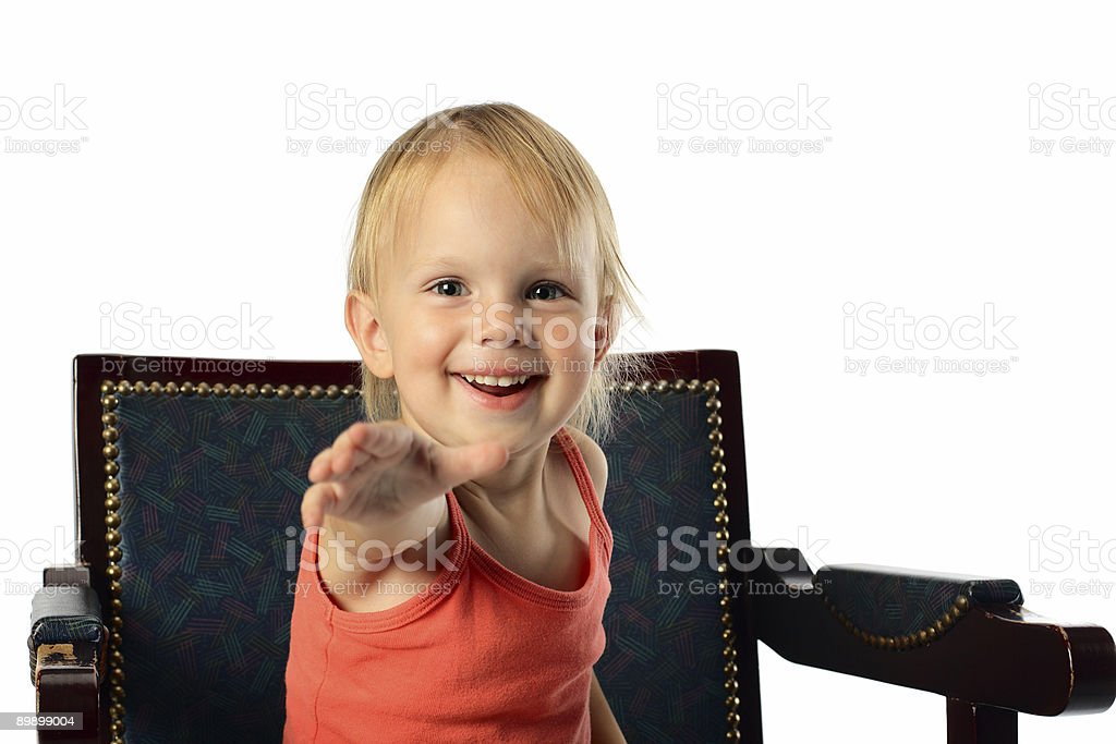 little girl offer hand to audience royalty-free stock photo