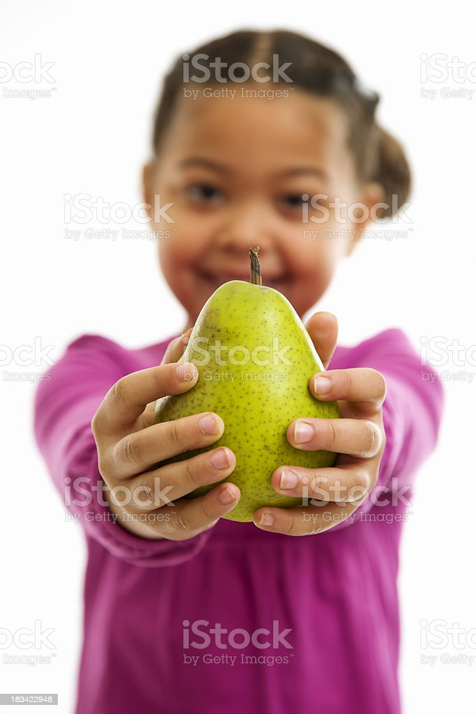 Little Girl Offering Viewer an Pear royalty-free stock photo