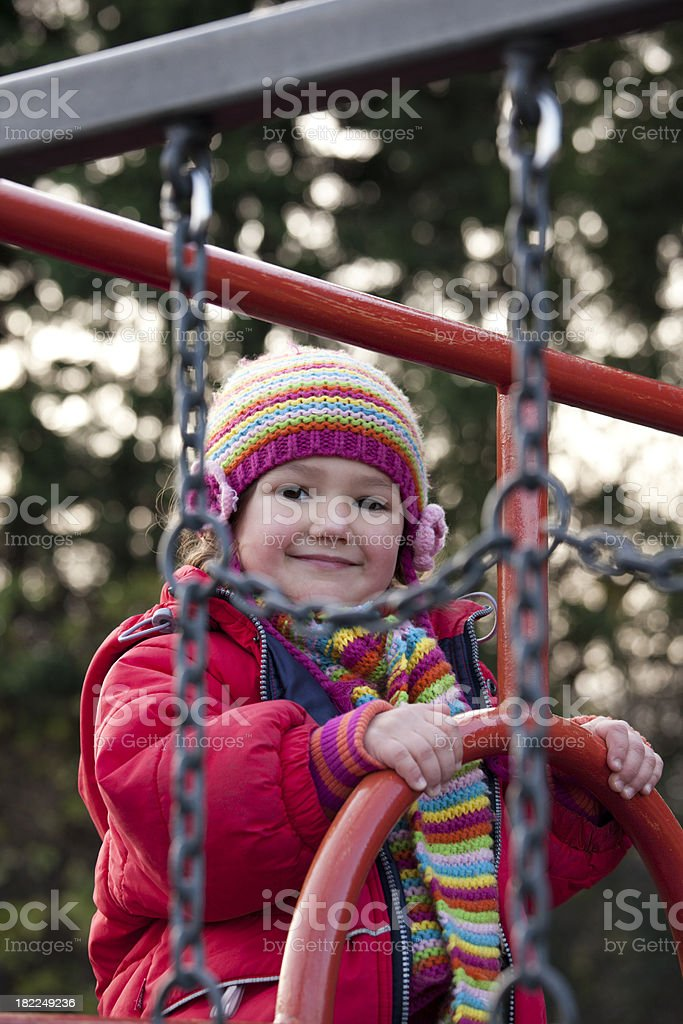 Little girl on a climbing frame royalty-free stock photo