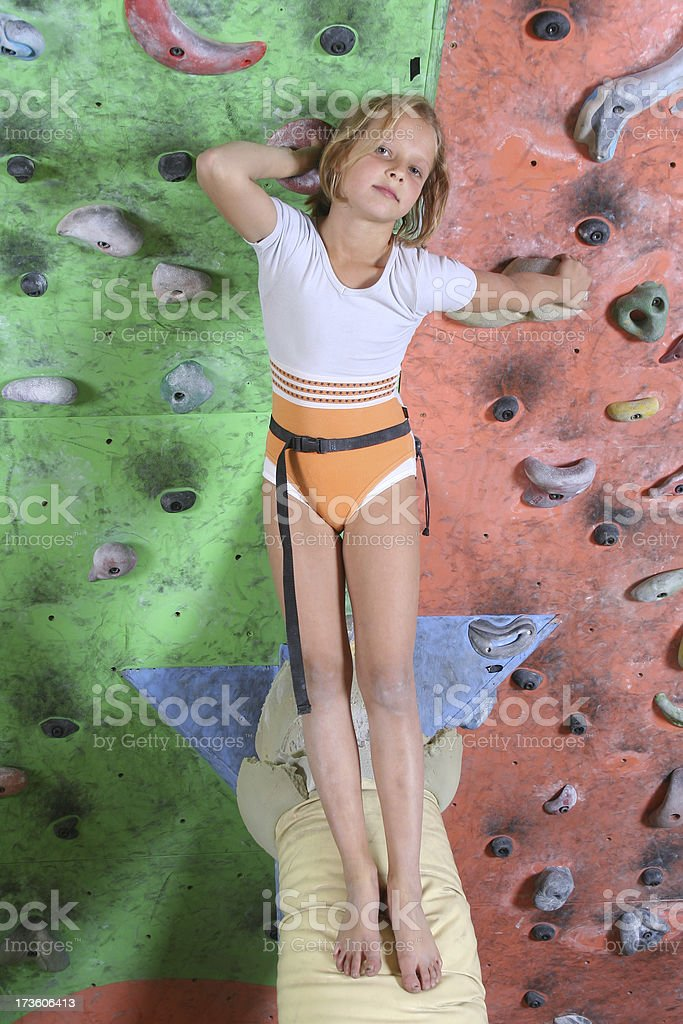 Little girl on a climbing wall royalty-free stock photo