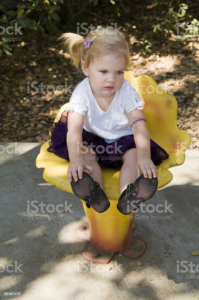 Little Girl on a Flower Chair stock photo