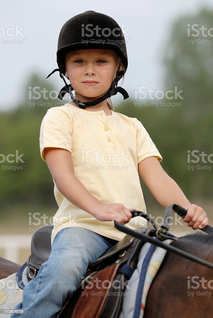 Little girl on a horse stock photo