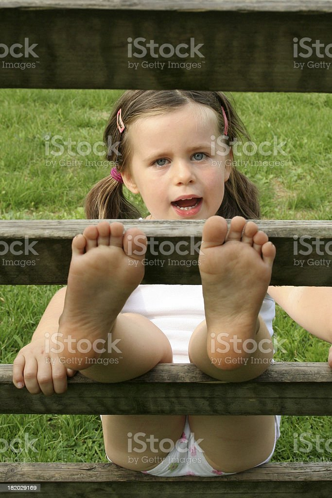 little girl on a ladder stock photo