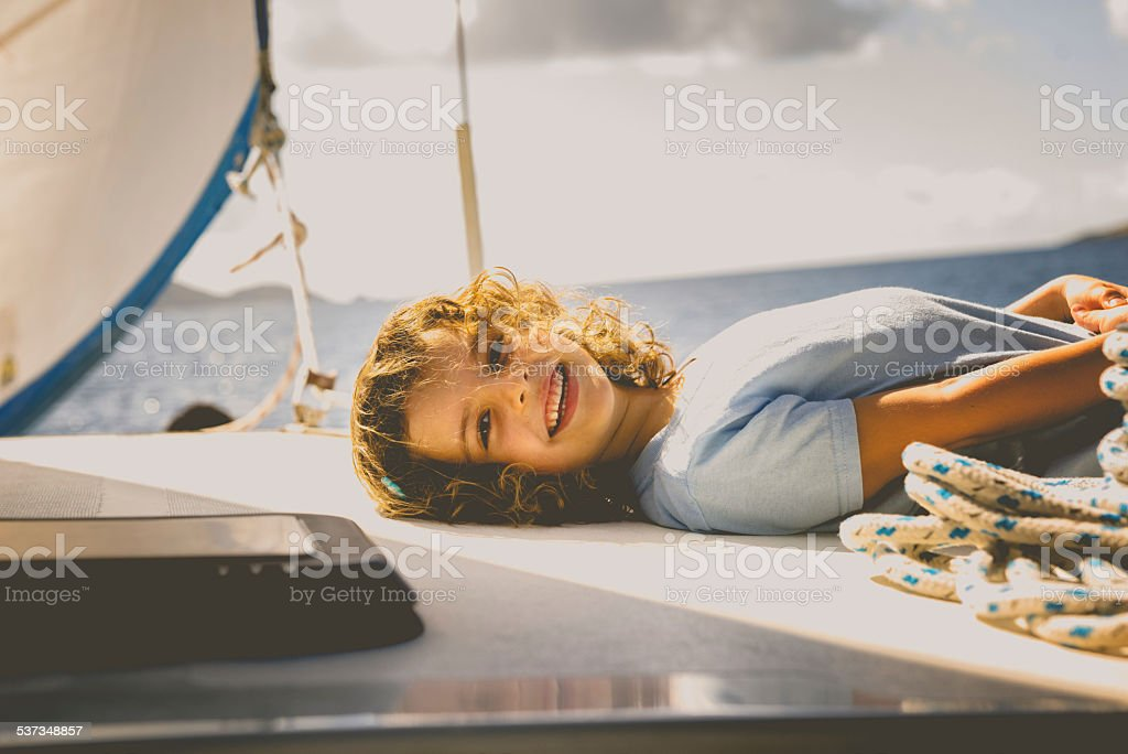 Little Girl on a Sailboat stock photo