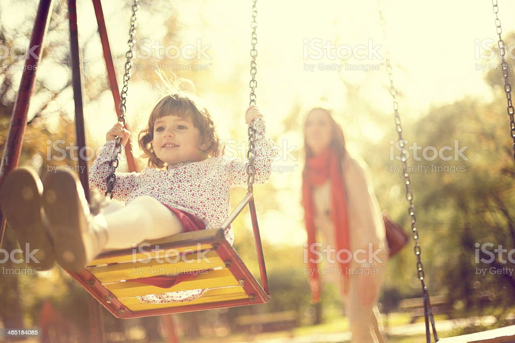 Little Girl on a Swing stock photo