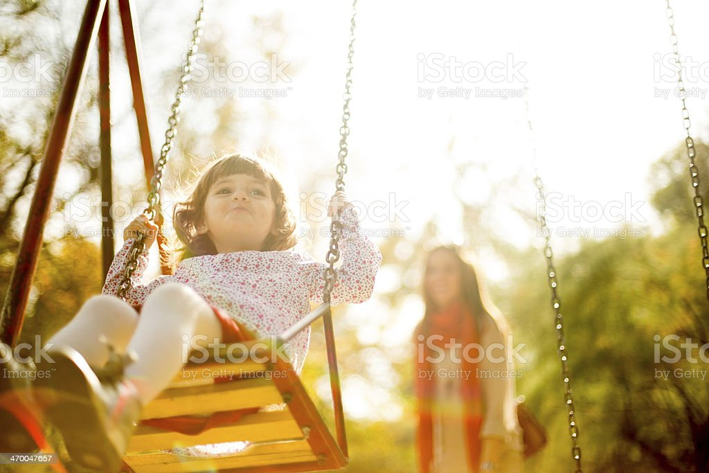 Little Girl on a Swing stock photo
