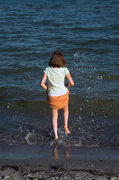 little girl on beach - alintal stock pictures, royalty-free photos & images