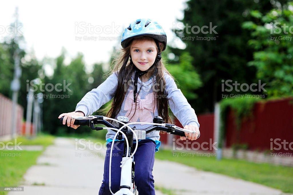 Little girl on bike stock photo