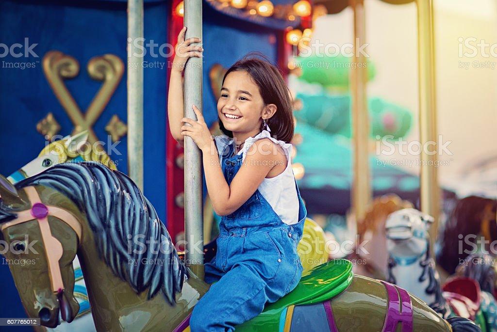Little girl on carousel stock photo
