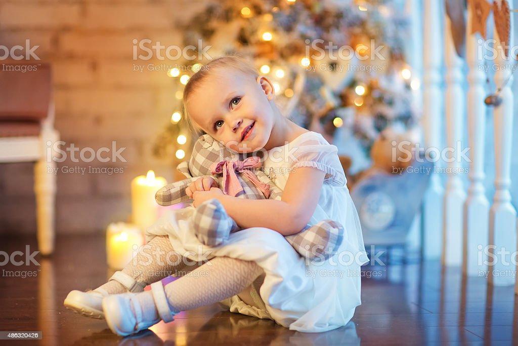Little girl on Christmas Eve stock photo