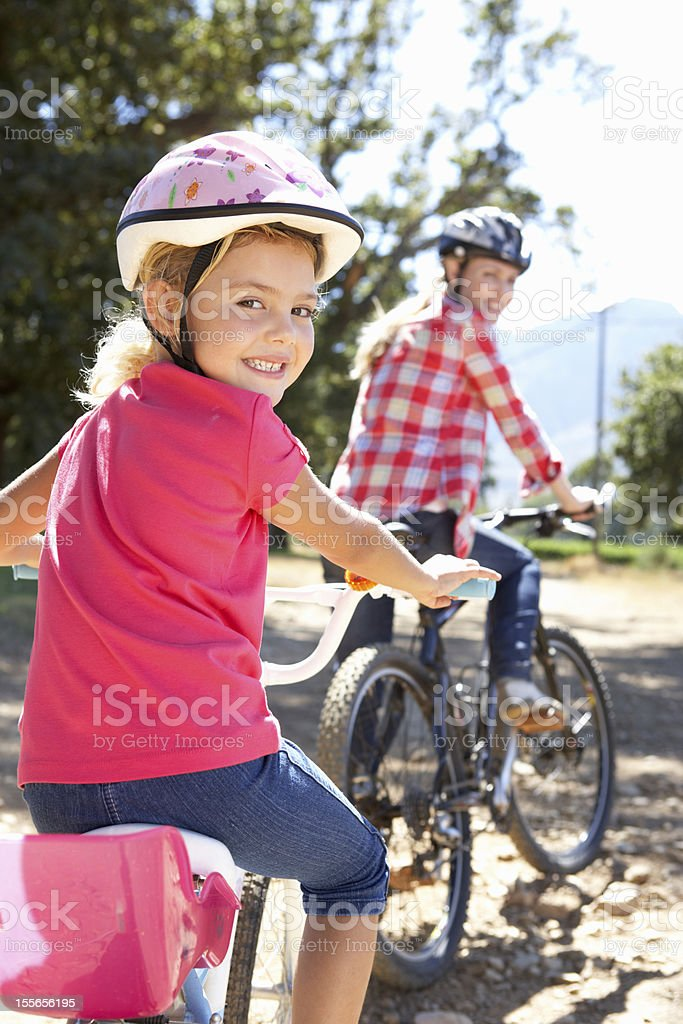 Little girl on country bike ride with mom stock photo