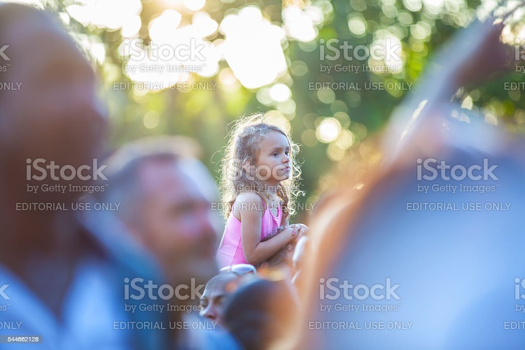 little girl on her father shoulders, Amsterdam Roots festival stock photo