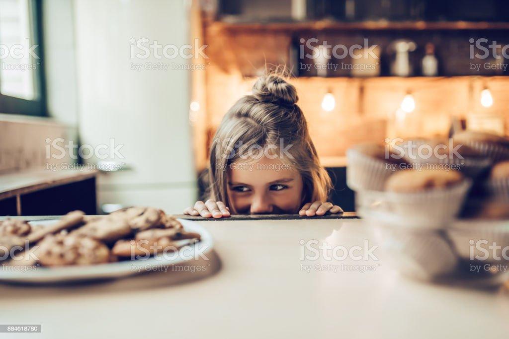 Little girl on kitchen. stock photo