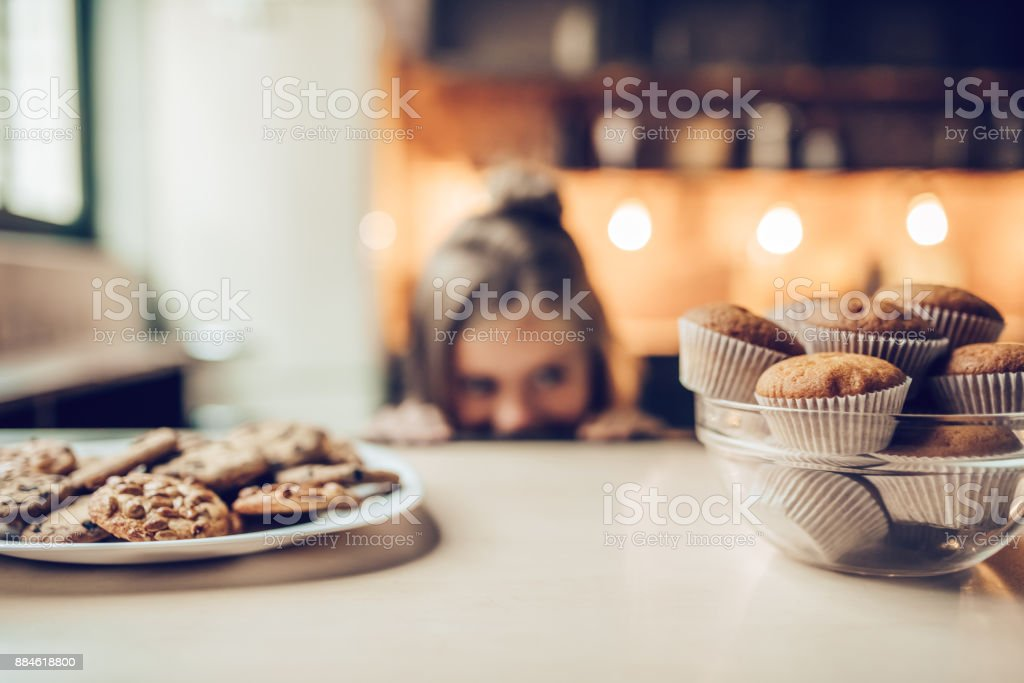 Little girl on kitchen. royalty-free stock photo