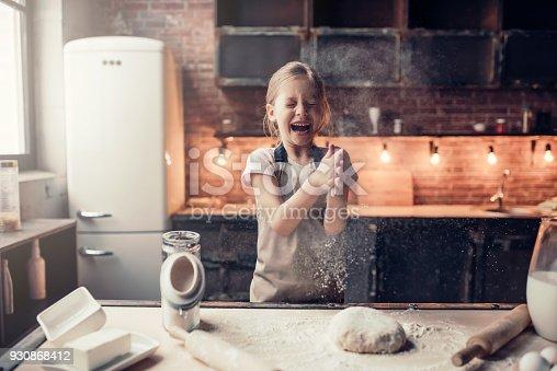 istock Little girl on kitchen 930868412
