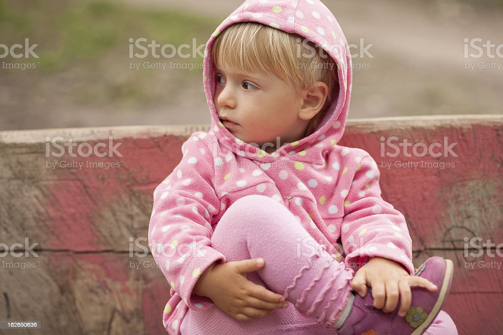 Little Girl on Park Bench royalty-free stock photo