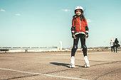 portrait view on little girl on roller skates on Tempelhofer Feld in Berlin