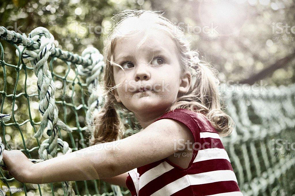 Little Girl On Rope Bridge royalty-free stock photo