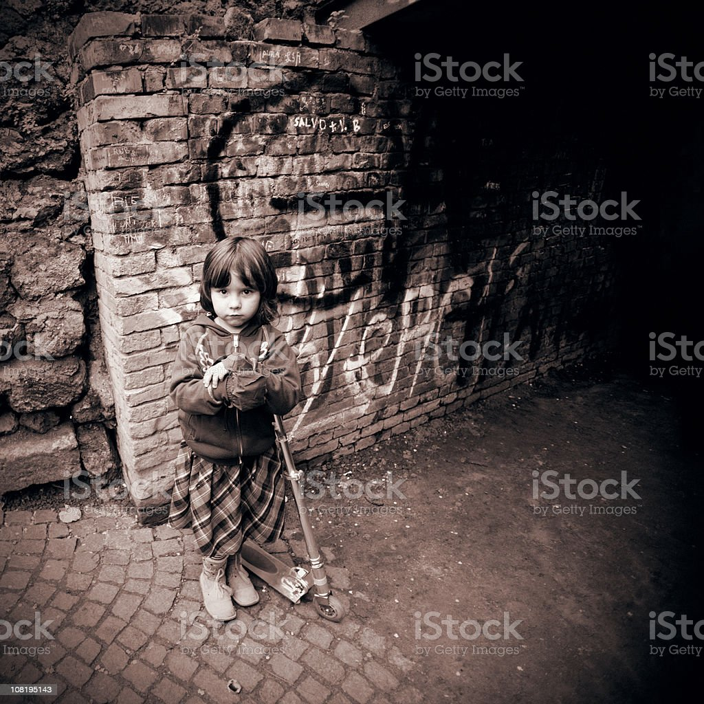 Little Girl on Scooter in Urban Setting royalty-free stock photo