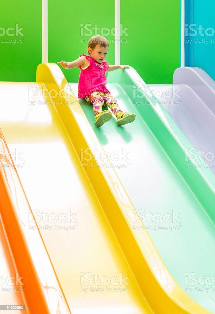 Little Girl on Slide stock photo