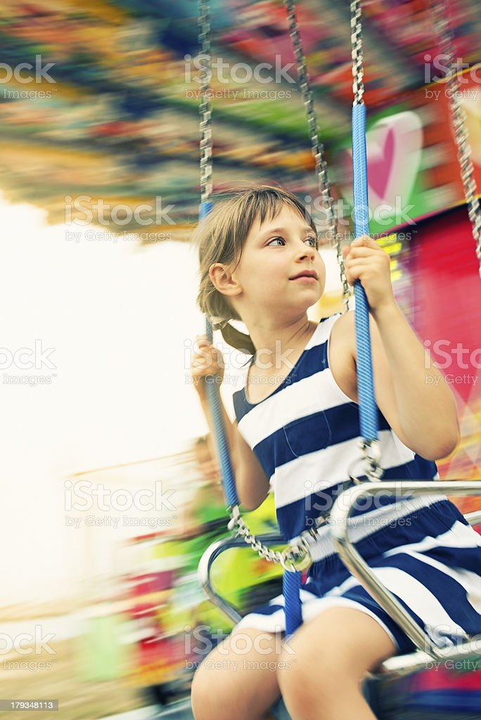 Little girl on swing carousel. royalty-free stock photo