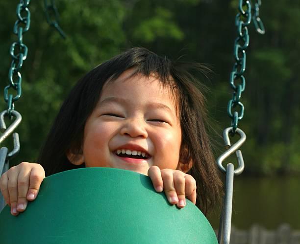 little girl on swing stock photo